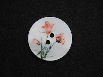 Bottone in madreperla stampata 22mm .