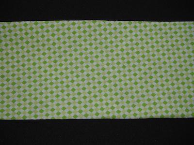 Nastro in sbieco senza alette fantasia verde. Composizione 100% cotone. Altezza 8cm