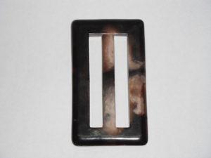 Fibbia resinata rettangolare. Dimensioni 7cmx4cm